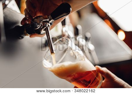 Light Draft Cold Beer Pour In Glass From Crane In Pub