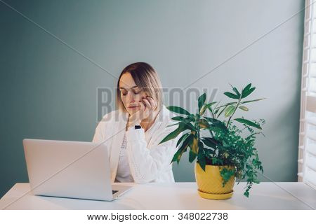 Tired Sleepy Caucasian Business Woman Working On Laptop Computer. Freelancer Working Remotely On Int