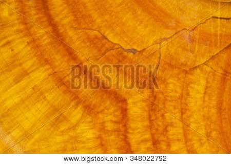 Textured Vains And Patern Of Orange Marbled Stone Surface