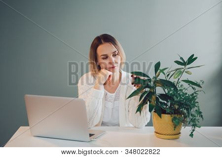 Tired Pensive Caucasian Business Woman Working On Laptop Computer. Freelancer Working Remotely On In