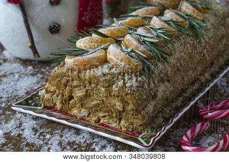 Cake With Puff Pastry And Cream With Tangerines And Rosemary
