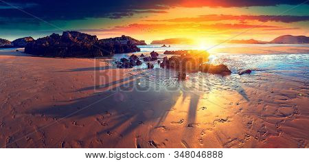 Scenery Rocks And Cliff In Beach In Noja Village,cantabria,spain.scenic Beach Landscape And Sunset