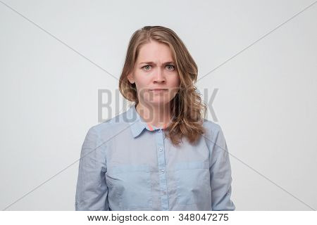 Serious Caucasian Woman Frowning Her Face And Looking At Camera With Mistrust.