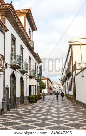 Ponta Delgada, Azores, Portugal - Jan 12, 2020: Cobbled Street In The Historical Center Of The Portu
