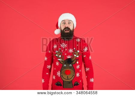 Sweater With Deer. Hipster Bearded Man Wear Winter Sweater And Hat Red Background. Check Out My Swea