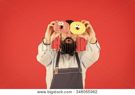 Sweets And Cakes. Junk Food. Hipster Bearded Baker Hold Donuts. Eat Donut. Cheerful Mood. Doughnut C