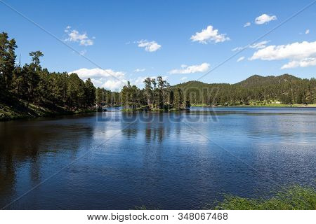 Stockade Lake In Custer State Park On A Clear Spring Day With Calm Water And People Enjoying The Wea