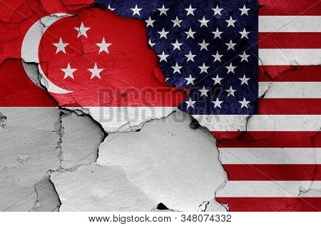 Flags Of Singapore And Usa Painted On Cracked Wall