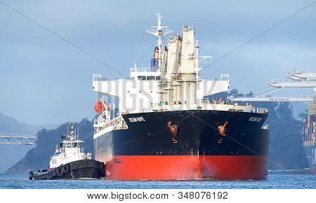 Oakland, Ca - Jan 9, 2020: Tugboats Assisting Bulk Carrier Ocean Hope To Schnitzel Steel At The Port