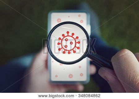 Mobile Security Concept: Hand Holding An Infected Generated Smartphone. Screen Graphics Are Made Up.