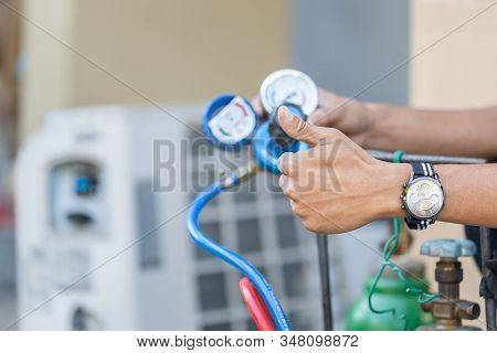 Close Up Of Air Conditioning Repair, Repairman On The Floor Fixing Air Conditioning System