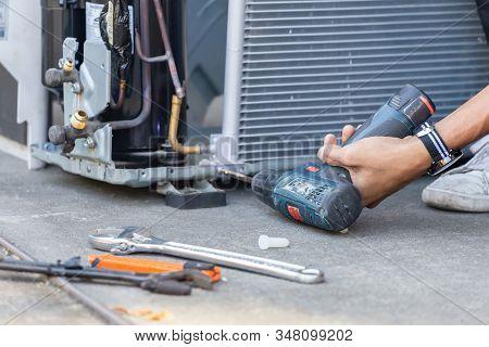 Selective Focus Air Conditioning Repair, Technician Man Hands Using A Screwdriver Fixing Modern Air