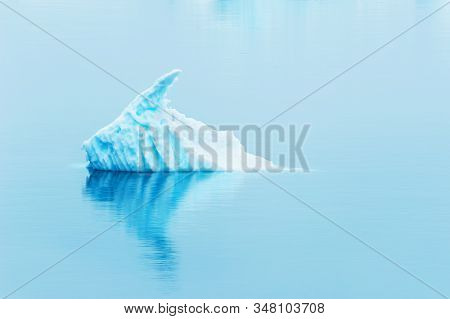 Iceberg In Atlantic Ocean. Ilulissat Icefjord, West Coast Of Greenland