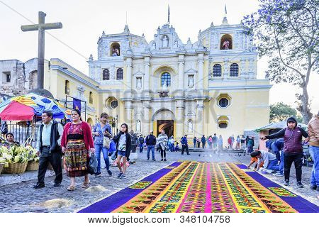 Antigua, Guatemala -  April 14, 2019: Making Dyed Sawdust Palm Sunday Procession Carpet During Early