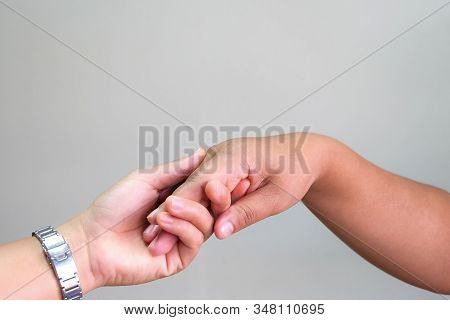 Close Up Hand Couple On Gray Background.