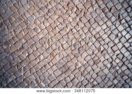Stone Background. The Path Consists Of A Stone Mosaic. The Texture Of The Stone, Top View