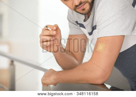 Man With Nicotine Patch And Cigarette Indoors, Closeup