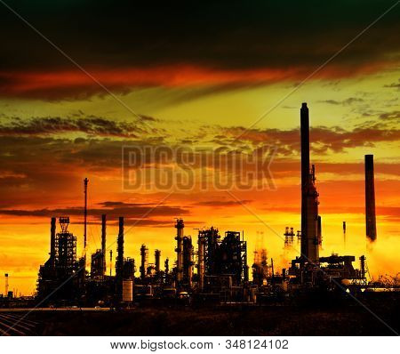 Refinery power station at sunset