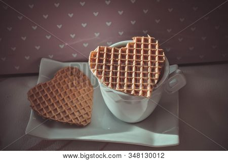 Romantic Postcard With A Cup Of Coffee And Two Waffle Hearts On A Pink Background Of Hearts