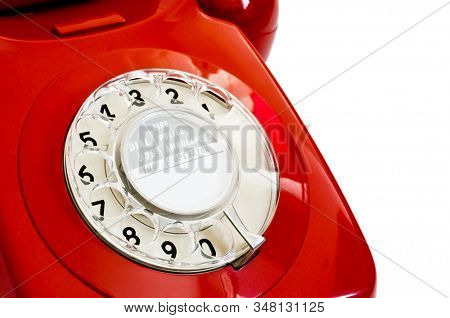 Close up of dial on retro red telephone