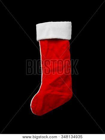 Red Christmas stocking on black
