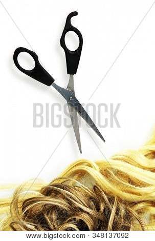 Hairdressing scissors and blond hair