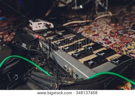 Electric Guitar And Guitar Audio Processing Effects On A Studio Floor. Electric Guitar And Stomp Box