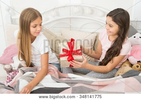 Giving Tuesday. Small Child Giving Present To Sister. Little Girl Enjoy Gift Giving. Giving And Rece