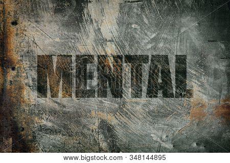 Mental written on messy steel background