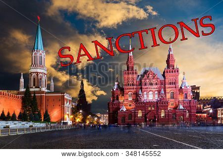 Red Square In Moscow, Russia With The Inscription Sanctions. Us Sanctions Against Russia
