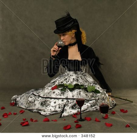 portrait of attractive lady drinking wine. dressed in polish amazon clothes and silk hat with veil poster