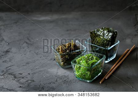 Traditional Japanese Snack - Chuka Wakame Seaweed Salad And Crispy Roasted Nori Sheets In Wooden Bow
