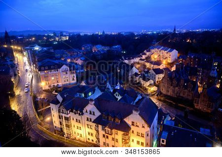 Top Panoramic View On Dean Village In Old Part Of Edinburgh City At Night, Capital Of Scotland