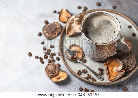 Mushroom Coffee, A Ceramic Cup, Mushrooms And Coffee Beans On Stone Concrete Background. New Superfo