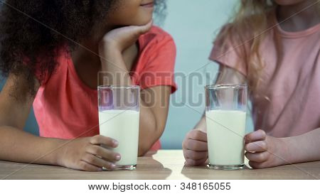 Multi-ethnic Kids Drinking Milk And Smiling To Each Other, Healthy Nutrition