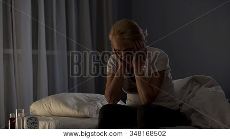 Tired Middle-aged Woman Sitting On Bed At Night, Insomnia Disease, Problem
