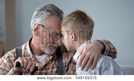 Grandpa And Grandson Leaning Foreheads Together, Family Love, Sentimentality