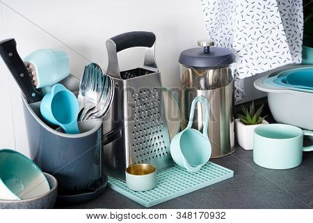 Kitchen Utensils On The Background Of The Kitchen, Close-up.  Modern Kitchen, Background With Cookin