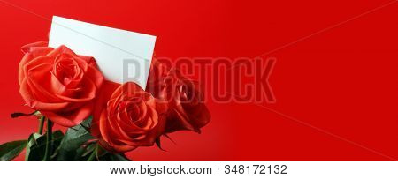 Red rose bouquet with empty card frame. Horizontal background.