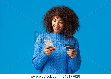 Shopping, Holidays And Presents Concept. Attractive Smiling African-american Woman Paying For Online