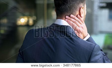 Office Male Massaging Neck Muscles, Pinched Nerve, Whiplash Injury, Inflammation