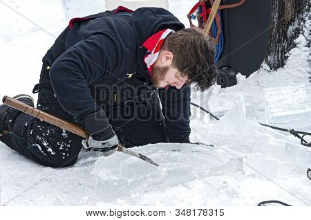 St. Paul, Mn/usa - January 25, 2020: Ice Sculptor On Ground Shaping Ice During Competition At Saint