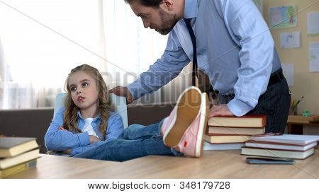 Badly Behaved Daughter Sitting At Table, Ignoring Fathers Remarks, Conflict