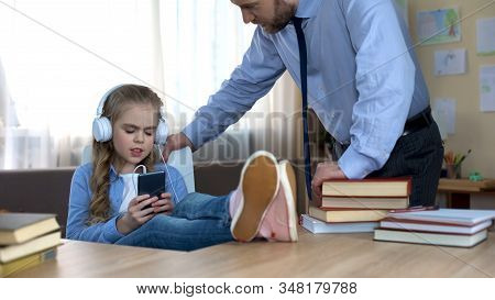 Single Father Trying To Speak With Daughter, Listening To Music And Ignoring Him