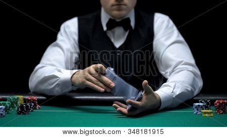 Croupier Professionally Shuffling Poker Cards In Front Of Camera, Gambling