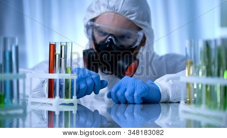 Male Chemist Checking Test Tubes With Biohazard Substance, Toxicology Testing