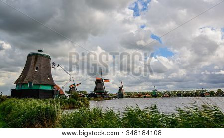 Zaanse Schans, Holland, August 2019. Northeast Amsterdam Is Located On The Zaan River. View Of The M