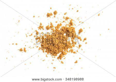 Natural unrefined brown sugar on white background