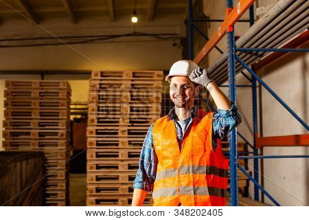 Smiling Warehouse Workers In Protective Helmet Portrait