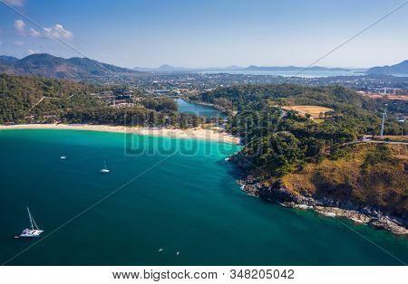 Aerial view of Nai Harn beach during high season, Phuket island, Thailand